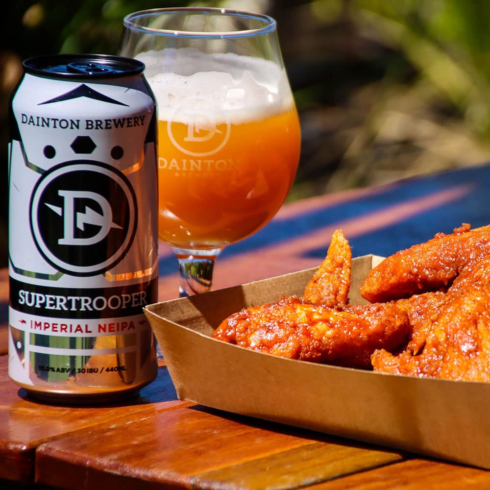 Dainton Brewery Beer & Taphouse chicken wings and beer in a glass and can