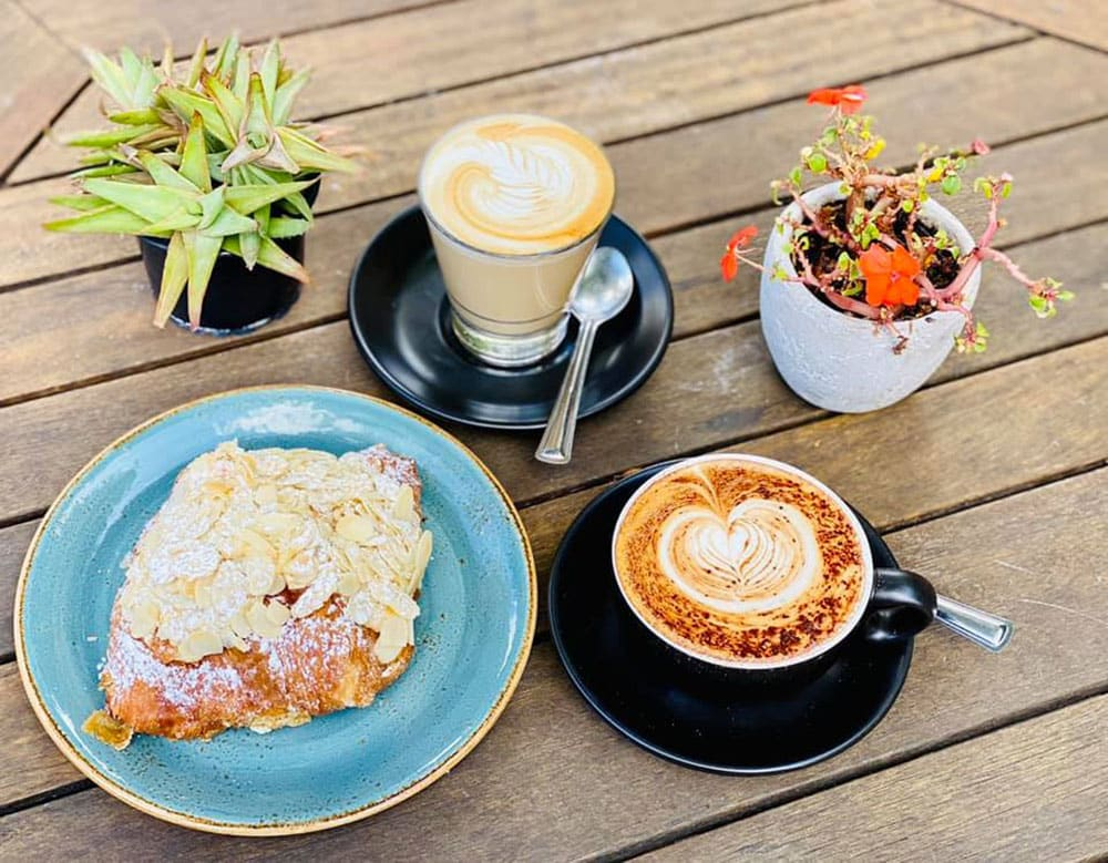 Steamin Mugs latte and cappuccino and almond croissant